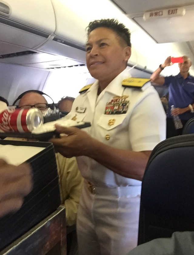 Day 11B - RADM Bette Bolivar Lends a Hand Collecting Dinner Trays on Return Flight to Guam.