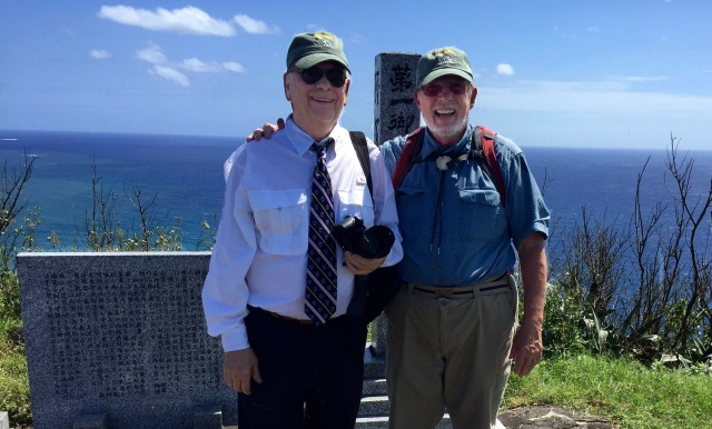 Day 11A - Frank and Bill Stand Beside one of the Several Monuments Atop Mt. Suribachi.